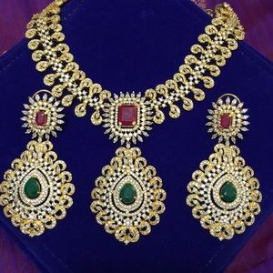 Necklace set with ruby and emerald stones